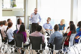 Businessman Addressing Multi-Cultural Office Staff Meeting — Stock Photo