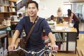 Architect Arrives At Work On Bike Pushing It Through Office — Stockfoto
