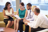Group Of Businesspeople Having Meeting In Office Lobby — Stock Photo