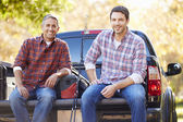 Portrait Of Two Men In Pick Up Truck On Camping Holiday — Stockfoto