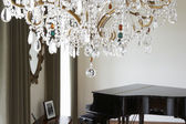 Room In Modern House With Chandelier And Grand Piano — Stock Photo