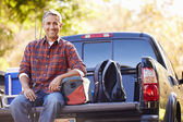 Portrait Of Man Sitting In Pick Up Truck On Camping Holiday — Stock Photo