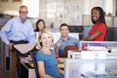 Portrait Of Businesspeople In Modern Open Plan Office — Stock Photo
