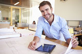 Male Architect With Digital Tablet Studying Plans In Office — Stock Photo