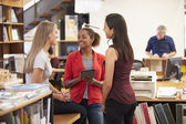 Three Female Architects Chatting In Modern Office Together — ストック写真