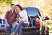 Couple Sitting In Pick Up Truck On Camping Holiday — Stockfoto