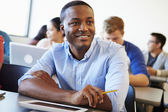 Male University Student Using Digital Tablet In Classroom — Stock Photo