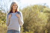 Woman Hiking In Countryside Wearing Backpack — Stock Photo