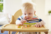 Baby Boy Eating Fruit — Foto de Stock