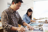 Male Architect Working On Model In Office — Stock Photo