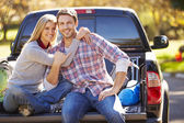 Couple Sitting In Pick Up Truck On Camping Holiday — Stock Photo