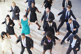 Overhead View Of Businesspeople Dancing In Office Lobby — Stock Photo