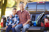 Father And Son Sitting In Pick Up Truck On Camping Holiday — Stockfoto