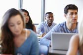 Male University Student Using Laptop In Classroom — Stock Photo