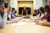 Female Boss Addressing Meeting Around Boardroom Table — Stock Photo