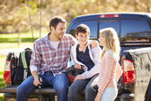 Father And Children Unpacking Truck On Camping Holiday — Stock Photo