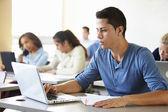 Male High School Student Using Laptop — Stock Photo