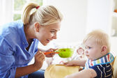 Mother Feeding Baby Boy — Stock Photo