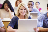 Female University Student Using Laptop In Lecture — Stock Photo