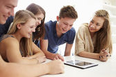 Teenagers Gathered Around Digital Tablet — Stock Photo