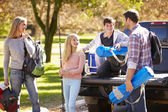 Family Unpacking Pick Up Truck On Camping Holiday — Stockfoto