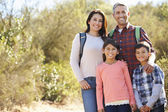 Portrait Of Family Hiking In Countryside Wearing Backpacks — Stockfoto