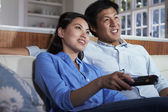 Asian Couple Watching TV Together — Stock Photo