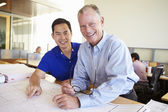Architects Studying Plans In Modern Office Together — Stock Photo