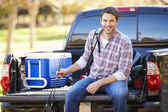 Man Sitting In Pick Up Truck On Camping Holiday — Stock Photo