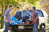 Fathers With Sons Unpacking Truck — Stock Photo