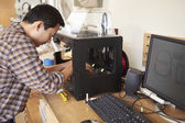 Male Architect Using 3D Printer In Office — Stock Photo
