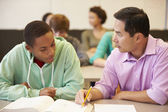 High School Teacher Helping Student — Stock Photo