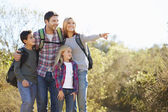 Family Hiking In Countryside Wearing Backpacks — Stock Photo