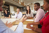 Six Architects Sitting Around Table Having Meeting — Stock Photo