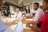 Six Architects Sitting Around Table Having Meeting — Stock Photo