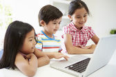 Three Asian Children Using Laptop — Foto Stock