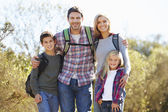 Portrait Of Family Hiking In Countryside Wearing Backpacks — Stock Photo