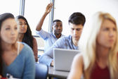 Male University Student Using Laptop In Classroom — Stok fotoğraf
