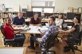 Group Of Architects Meeting Around Desk — Stock Photo
