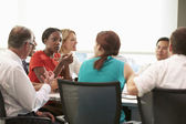 Group Of Businesspeople Meeting Around Boardroom Table — Stock Photo