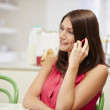 Hispanic Woman Talking On Mobile Phone At Home — Stock Photo #50476299