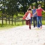 Hispanic Family Taking Dog For Walk In Countryside — Stock Photo #50473879