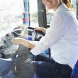 Portrait Of Female Bus Driver Behind Wheel — Stock Photo #50473931