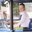 Portrait Of Female Bus Driver Behind Wheel — Stock Photo #50474027