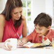 Mother Helping Son With Homework — Stock Photo #50474199