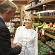 Bank Manager Meeting With Female Owner Of Farm Shop — Stock Photo #50474259
