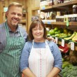 Two Sales Assistant At Vegetable Counter Of Farm Shop — Stock Photo #50474267