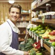 Male Sales Assistant At Vegetable Counter Of Farm Shop — Stock Photo #50474269
