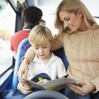 Mother And Son Going To School On Bus Together — Stock Photo #50474381