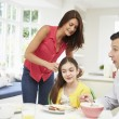 Family Having Breakfast Before Husband Goes To Work — Stock Photo #50474403